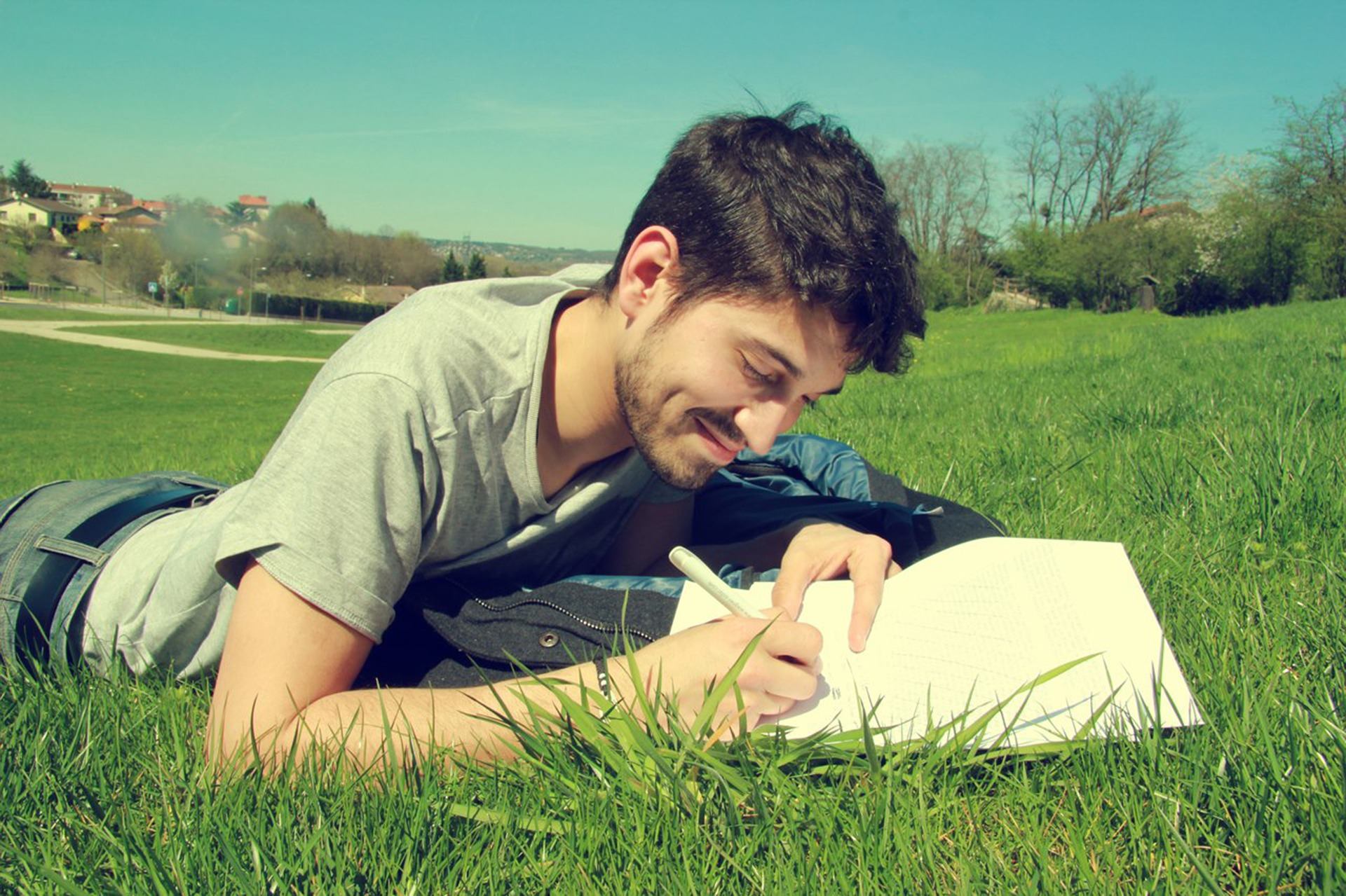 Man writing outdoors